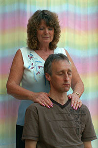 The author performing a seated Angelic Reiki treatment